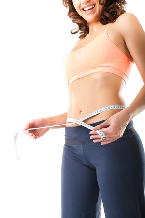 girth: Diet - young woman is measuring her waist with measuring tape Stock Photo