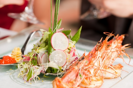 Close-up of fresh cooked shrimp on serving plate photo