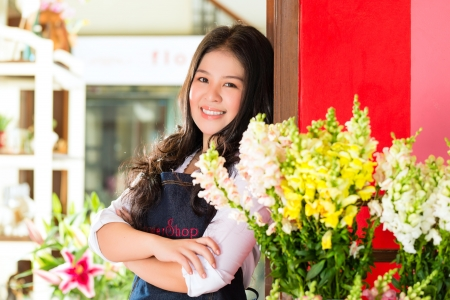 shops: Friendly Asian florist or Saleswoman in a flower shop