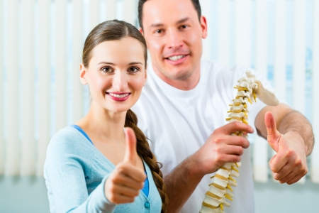 physical therapy: Physiotherapist and patient in a practise after a successfully treatment is the diagnosis a clear improvement, thumbs up