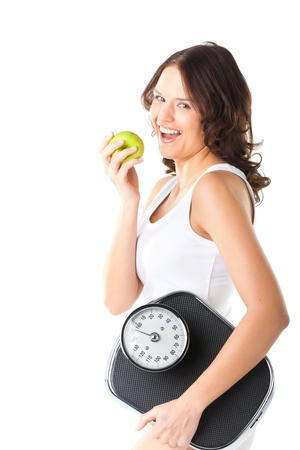 Diet and weight, young woman with scale under her arm and apple photo