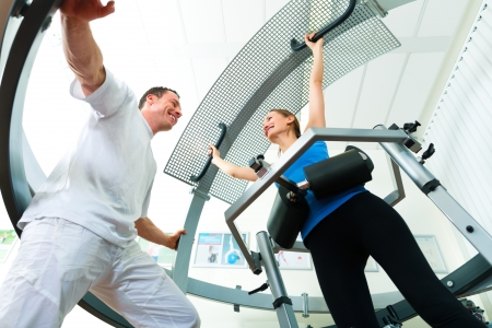 physical therapist: Space Curl - Patient at the physiotherapy making physical exercises with her therapist