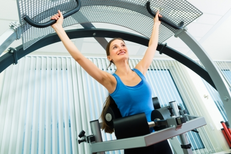 therapy equipment: Space Curl - Patient at the physiotherapy making physical exercises with special equipment
