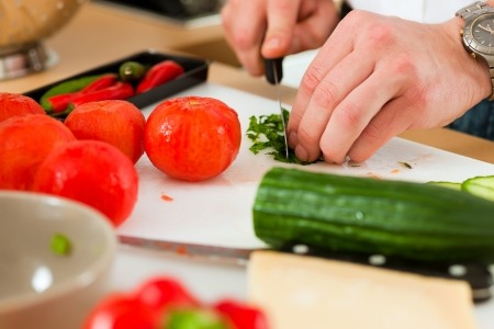 Man in the kitchen - only hands to be seen - is preparing the vegetables for dinner or lunch Stock Photo - 18838797