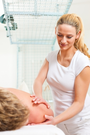 Patient at the physiotherapy gets massage or lymphatic drainage photo