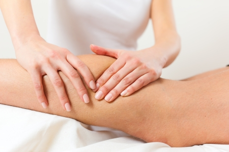 lymphatic drainage therapy: Patient at the physiotherapy gets massage or lymphatic drainage Stock Photo