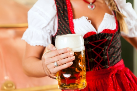 tracht: Woman in Bavarian Tracht, a female brewer, with beer stein in brewery