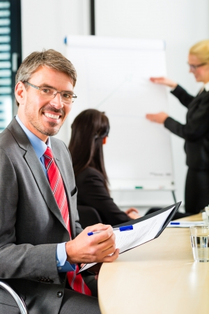 Business - businesspeople have a meeting with presentation in office, they negotiate a contract - Portrait of a businessman Stock Photo - 19000758
