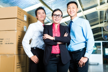 forwarding agency: Manager, owner or businesspeople in a warehouse of a forwarding agency or a factory