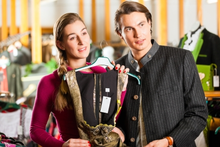 Traditional clothes - young couple is buying Tracht or dirndl in a shop Stock Photo - 19226327