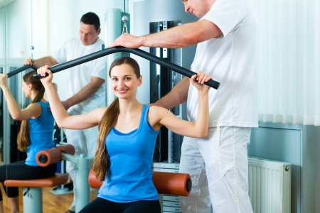 therapists: Patient at the physiotherapy making physical exercises with her therapist Stock Photo