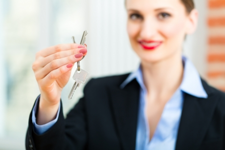 accommodation broker: Young realtor is with keys in an apartment, it could be the tenant too Stock Photo