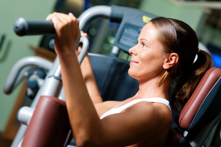 woman lifting weights: Working out  Stock Photo