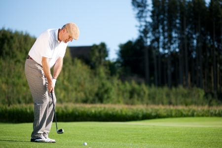 playing golf: Senior golf player in summer