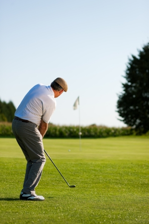 Senior golf player in summer photo