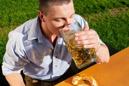 lederhosen: Man in Lederhosen drinking beer
