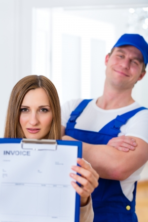 Craftsman or plumber giving overpriced invoice for the service photo
