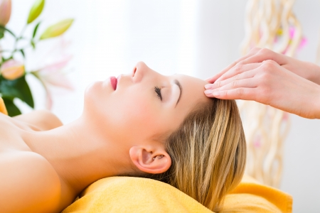 massage face: Wellness - woman receiving head or face massage in spa