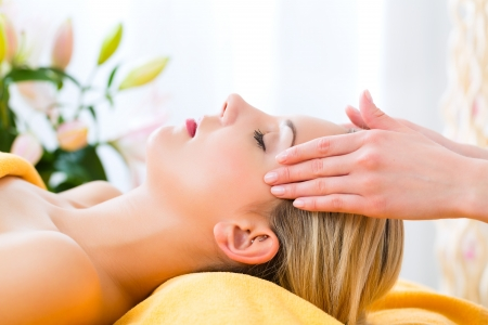 therapists: Wellness - woman receiving head or face massage in spa
