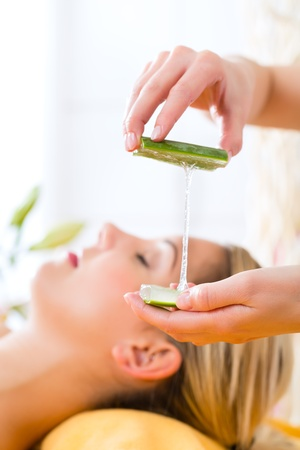Wellness - woman receiving head or face massage whit aloe Vera in spa Stock Photo - 19761936