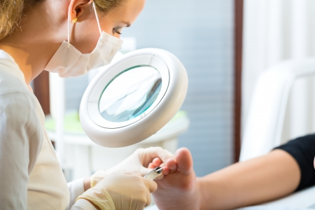 podiatry: Woman receiving podiatry treatment in a Day Spa Stock Photo