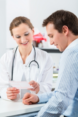 doctor appointment: Female doctor with her patient in a consultation in clinic explaining something Stock Photo