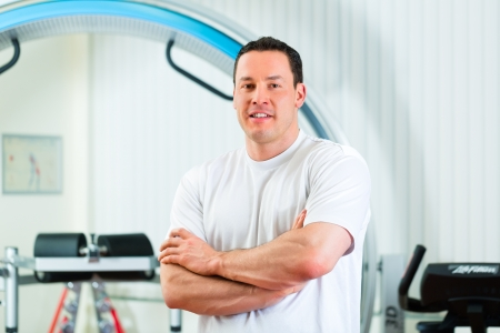 Space Curl - Portrait of a physical therapist in his practice in front an exercise machine photo