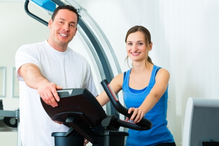 muscle tension: Patient at the physiotherapy making physical exercises with her therapist Stock Photo