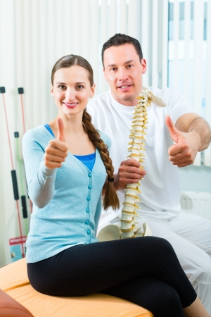 the vertebral spine: Physiotherapist and patient in a practise after a successfully treatment is the diagnosis a clear improvement, thumbs up