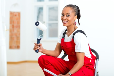 Young woman in overalls renovated because she moved to their new or old home Stock Photo - 19809446