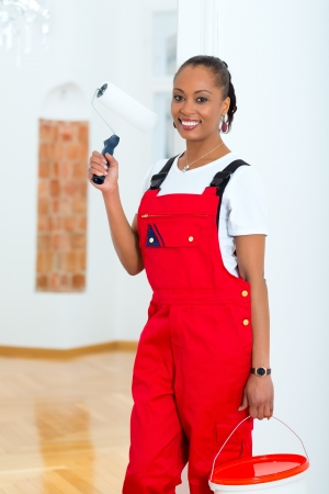 Young woman in overalls renovated because she moved to their new or old home Stock Photo - 19809460