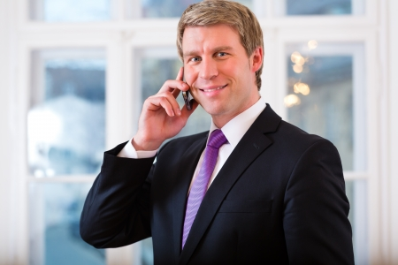 Young lawyer or businessman working in his Office, and on the telephone is a customer or client photo