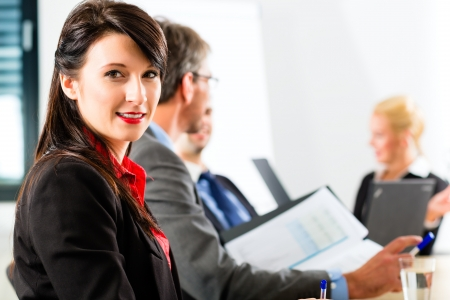 Business - businesspeople have a meeting with presentation in office, they negotiate a contract - Portrait of a businesswoman photo