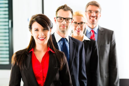 group photo: Business - group of successful businesspeople posing for group photo in office Stock Photo