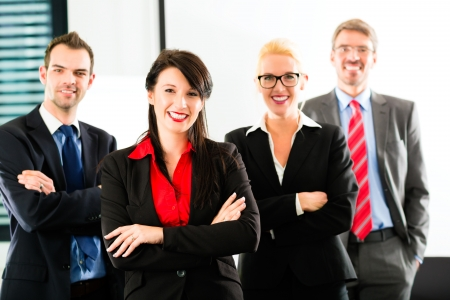 Business - group of successful and confident businesspeople being a team and showing it photo