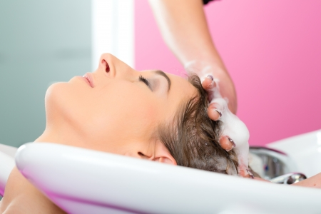 rinsing: Woman at the hairdresser getting her hair washed and rinsed feeling visibly well