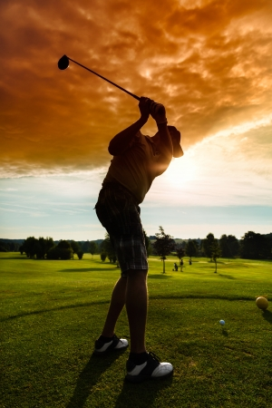 golf swing: Young golf player on course doing golf swing, he presumably does exercise