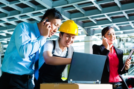 Worker or production manager and customer service, look on a laptop in a textile factory and help on the phone photo