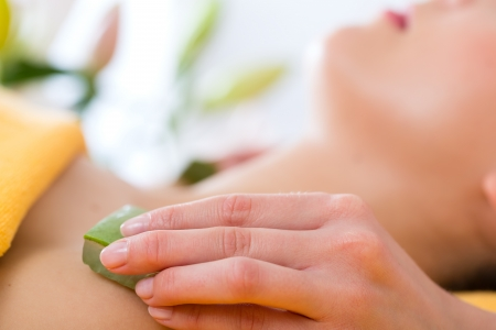Wellness - woman receiving head or face massage whit aloe Vera in spa Stock Photo - 20052892