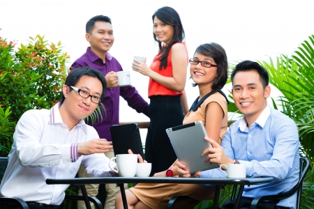 Asian Creative team - young businesspeople are successful with a project photo