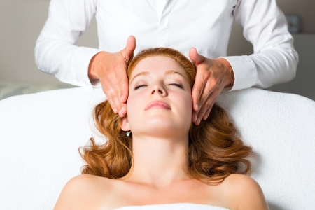Wellness - woman getting massage in Spa, it is a massage for the head or face Stock Photo - 20112817