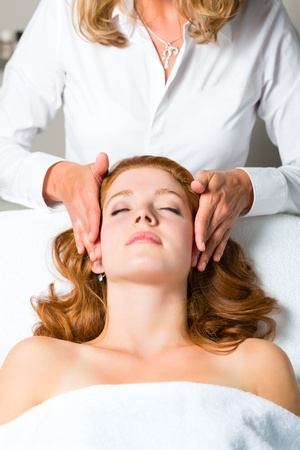 Wellness - woman getting massage in Spa, it is a massage for the head or face Stock Photo - 20112813