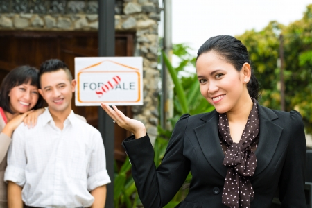 accommodation broker: Real estate market - young Indonesian couple looking for real estate apartment or house to rent or buy