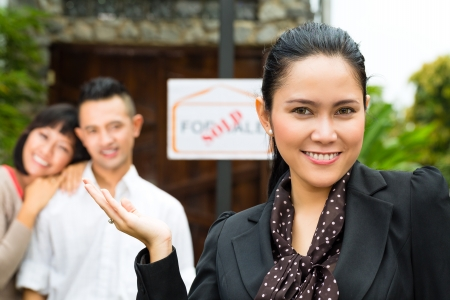 landlord: Real estate market - young Indonesian couple looking for real estate apartment or house to rent or buy