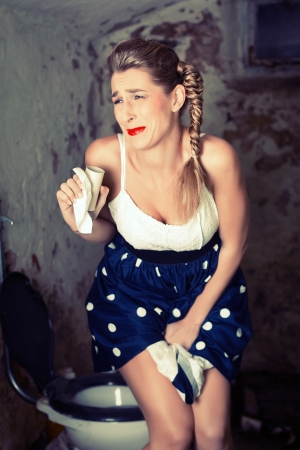 peeing: Woman peeing on the shabby toilet with not bathroom paper