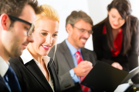 Business - businesspeople have a meeting or workshop with presentation in office, they negotiate or sign a contract photo