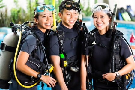 Asian people at the diver Course on holiday in wetsuit with an oxygen tank photo