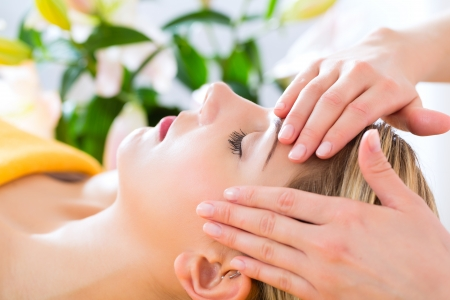 alternative wellness: Wellness - woman receiving head or face massage in spa