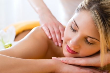 spa: Wellness - woman receiving body or back massage in spa Stock Photo