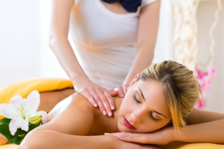 therapist: Wellness - woman receiving body or back massage in spa Stock Photo